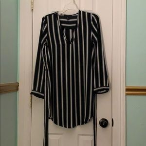 Long sleeve, black and white striped dress.